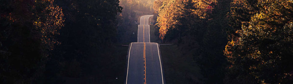 Contact Us header image of long straight road will hills.