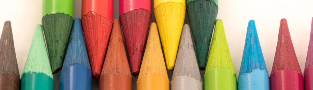 BELC header image of colored pencil tips lined up