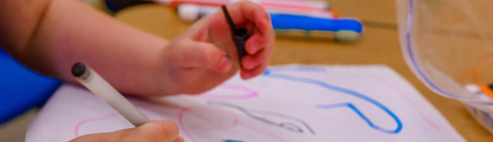 Bethel Early Learning Center header image of child coloring.