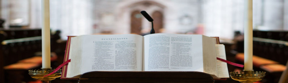 About header image with Bible on stand in chruch.